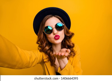 Close up photo beautiful dreamy funky she her lady make take selfies send air kiss boyfriend vacation red pomade lips lipstick wear hat sun specs formal-wear suit isolated yellow bright background