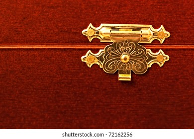 Close up photo of a beautiful graven chest lock