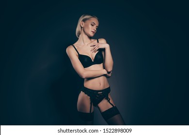 Close up photo beautiful half naked she her lady hands arms touch chest eyes closed mistress lace bikini stockings belt suspenders tenderness skinny shapes dream isolated dark black grey background