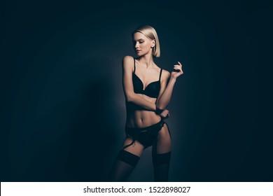 Close up photo beautiful half naked she her lady mistress bob hairdo lace bikini bra stockings suspenders look down empty space tenderness slim skinny shapes isolated dark black lights background