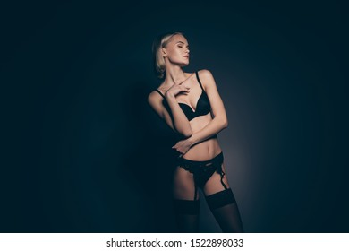 Close up photo beautiful half naked she her lady hands arms touch chest eyes closed mistress lace bikini bra stockings suspenders tenderness skinny shapes dream isolated dark black grey background
