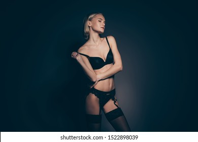 Close up photo beautiful half naked she her lady seductive eyes closed mistress lace bikini take off bra stockings suspenders tenderness skinny shapes dream dreamy isolated dark black grey background