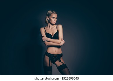 Close up photo beautiful half naked she her lady hold hands arms chest mistress lace bikini bra stockings suspenders look down empty space tenderness skinny shapes isolated dark black grey background