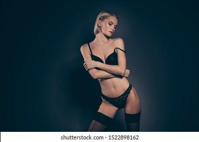 Close up photo beautiful half naked she her lady mistress bob hairdo lace bikini taking off silky bra stockings suspenders tenderness look slim skinny shapes isolated dark black lights background