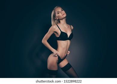 Close up photo beautiful half naked she her lady seductive look mistress lace bikini bra stockings suspenders dressing panties tender skinny slim shapes figure isolated dark black grey background