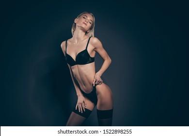 Close up photo beautiful half naked she her lady eyes closed pleasure mistress lace bikini bra stockings suspenders dressing panties tender skinny shapes figure isolated dark black grey background