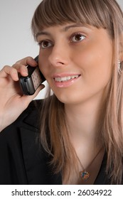 close up photo of the beautiful happy businesswoman talking on the phone