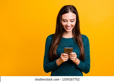 Close up photo beautiful her she lady hold arms hands telephone try test check new novelty play market game chatting friends wear green knitted pullover jumper isolated yellow background