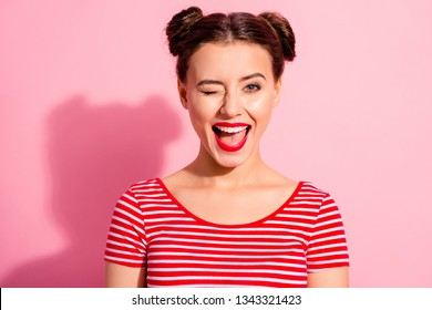 Close up photo beautiful she her lady pretty hairdo two buns bright pomade allure tempting big lips blinking boyfriend send love waves wear casual striped red white t-shirt isolated pink background