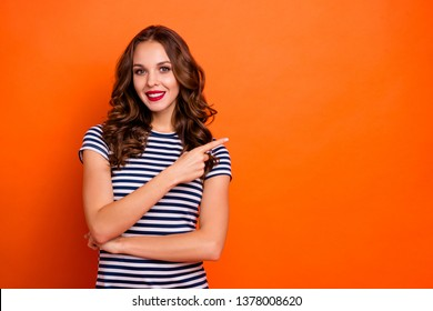 Close up photo beautiful she her lady tempting red pomade lips curly long hairdo indicate finger advising news novelty wear casual striped white blue t-shirt clothes isolated orange bright background