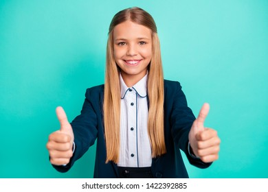 Close up photo beautiful she her little lady funky funny long hairdo hand arm thumb raised up approval quality news wear formalwear shirt blazer school form isolated bright teal turquoise background