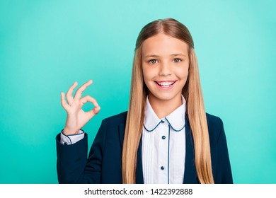 Close up photo beautiful she her little lady funky funny long hairstyle hand arm okey symbol approval quality news wear formalwear shirt blazer school form isolated bright teal turquoise background