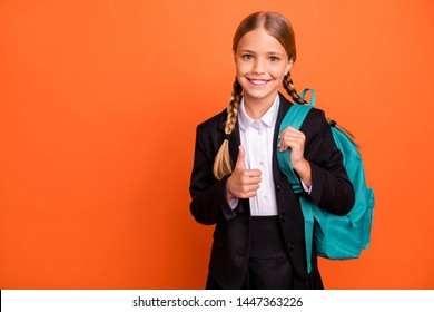 Close up photo beautiful she her little lady funky funny hairdo hand arm thumb raised up approval quality news wear formalwear shirt blazer skirt school form bag isolated bright orange background