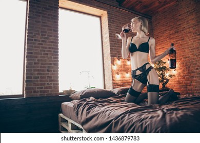 Close up photo beautiful tender gorgeous amazing crazy she her lady little drunk arms hands raise bottle alcohol beverage glass mouth stand knees sheets perfect shape bikini boudoir room indoors