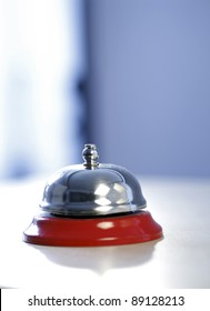 Close up photo of a bell in a hotel