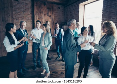 Close up photo business people different age race free leisure excited team building members gathering she her he him his golden beverage toasting best brigade friendship formal wear jackets shirts
