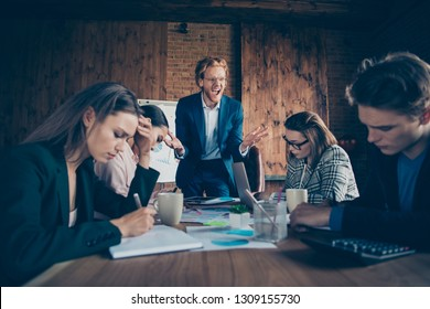 Close up photo business people he him his she her partners working office together boss angry anger yell mad crazy questions dressed suits formal wear mistakes noting every word