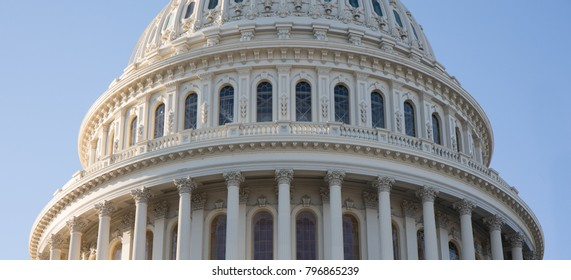 Close up photo of the Capitol Building rotunda in Washington, D.C. with a blue sky.