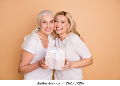 Close up photo of charming cute adults feel glad rejoice have anniversary send get giftbox 8-march cuddling feel tender gentle trust laugh isolated dressed trendy stylish outfit on beige background