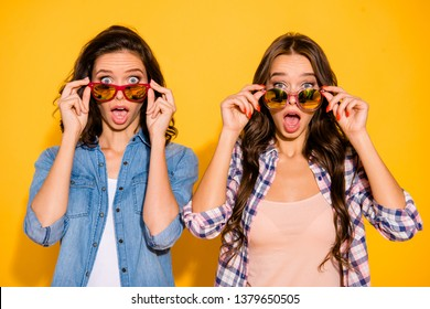 Close up photo charming funny hipsters person astonished impressed incredible information bargain news summer travel touch modern specs open mouth checked shirts denim isolated yellow background
