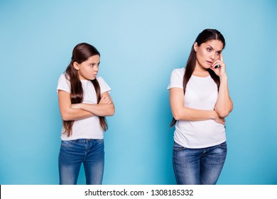 Close up photo cheer two people brown haired mum small little daughter hands arms crossed aggressive ignore not listen sick depression wear white t-shirts isolated bright blue background