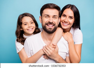 Close up photo of cheerful content three people with cute schoolkid hug lean shoulder cuddle piggyback enjoy weekends holidays wear white trendy t-shirt isolated over blue color background
