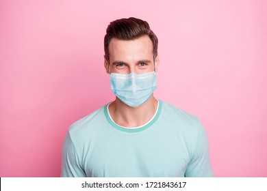 Close up photo of cheerful glad man look keep self-isolation social distance stop spread covid-19 infection wear white fabric mask isolated over pink color background