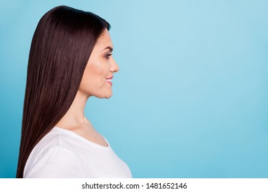 Close up photo of cheerful nice cute amazing girlfriend staring at someone away with pleasure while isolated with blue background