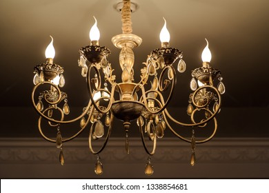 close up photo of chrystal chandelier lamp on the ceiling of a banquet hall