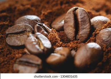 Close up photo of Coffee beans and ground coffee.