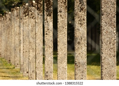 Close up photo of the concrete pillar fence at Dachau Nazi Concentration Camp, Munich, Germany