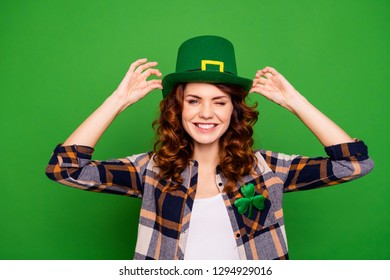 Close up photo of cool attractive she her lady showing cap advertising such style for holiday of saint patrick wearing casual checkered plaid shirt leprechaun headwear isolated on green background