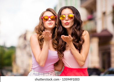 Close up photo cute attractive charming best ladies hug embrace travel trip long hair free time wear modern specs rose-colored outfit attract boys men males feel romance romantic coquettish town
