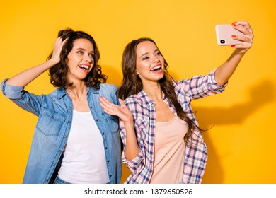 Close up photo cute carefree teens teenagers blog bloger make photo greeting touch head hair chill free time weekends childish hipsters wear checked jeans shirts outfit isolated yellow background