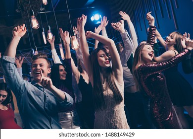 Close up photo of cute charming attractive millennial raise hands concert wear dress shirt free careless carefree feel cheerful content indoors