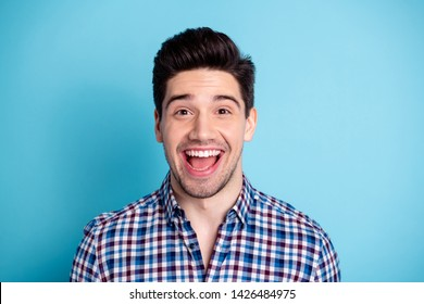 Close up photo of cute lovely astonished youth millennial impressed incredible sale information news shout open mouth reaction dressed plaid clothing spring isolated blue background