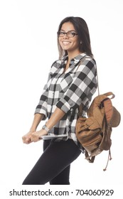 Close up photo of cute smiling young woman holding tablet in the hands and standing with leather bag on her shoulder. Isolated on white background.