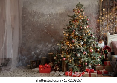 close up photo of a decorated Christmas tree near a white bed with pillows on it