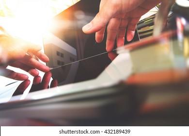 Close up photo of Designer hands working on Digital tablet laptop computer design. Sun effects, Blurred background
