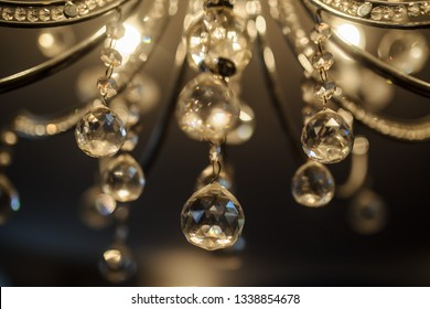 close up photo of of the details of a crystal chandelier in a banquet hall