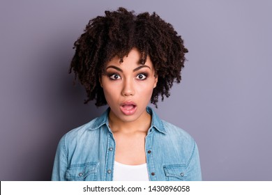 Close up photo of disappointed cute horrified lady youth impressed astonished by incredible news information wonder terrified wear modern denim clothes isolated grey background
