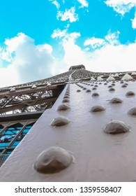 A close up photo of the Eiffel Tower's construction. Eiffel Tower is a famous iron tower downtown Paris, France. It is the main landmark in Paris, France.