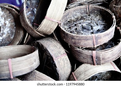Close up photo of empty and dirty mackerel baskets at the market in Thailand.