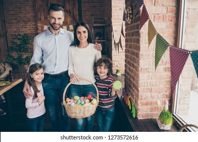 Close up photo of father mother with children uncle aunt standing holding eggs in hands cuddle toothy smile easter gladness decorations weekend vacation funny sweet emotions