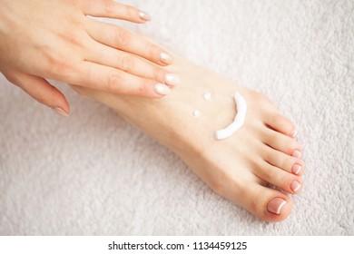 Close Up photo of a female feet at spa salon on pedicure procedure.