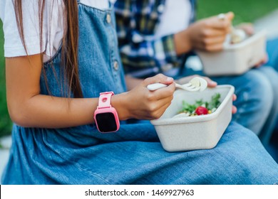 Close up photo, focus at smart watches on kids hands. After school with healthy eat.