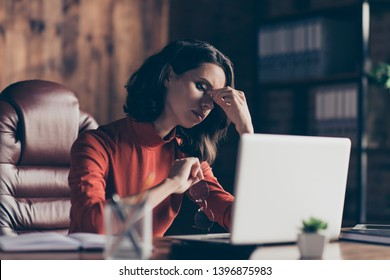 Close up photo focused thoughtful financier finance stress exhausted use device decide solve review touch nose brunette style stylish trendy specs red outfit sit armchair chair interior