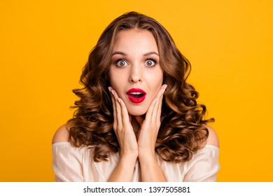 Close up photo frustrated teen cute astonished impressed horrible incredible information gossips rumors guilty worried put fingers cheeks bright pomade face isolated vivid background pastel blouse