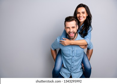 Close up photo funky amazing cheer she her he him his couple lady guy best friends piggyback ride buddies ready party wear casual jeans denim shirts outfit clothes isolated light grey background