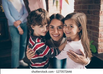 Close up photo of gathered relatives in decorated home house aunt cuddle to little girl boy children nephew niece looking gladly on camera missed little kids